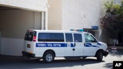 FILE - An Israeli prison service vehicle leaves the court house in Petah Tikva, Israel, July 6, 2014. Israeli authorities on Monday announced the arrest of an unidentified Israeli businessman allegedly involved in Guinea mine scheme.