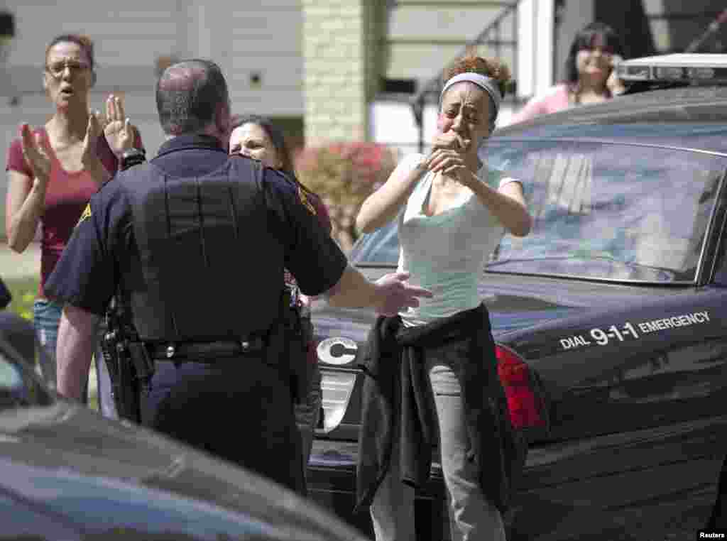Neighbors react as Amanda Berry arrives at her sister's home in Cleveland, Ohio, USA. Berry, Gina DeJesus, Michelle Knight and Berry's 6-year-old daughter escaped a Cleveland home where they were held captive for a decade.