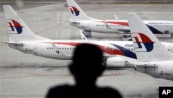 Fleet of Malaysia Airline planes on the tarmac of the Kuala Lumpur International Airport, in Malaysia, Jan. 29, 2015.