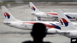 FILE - Fleet of Malaysia Airline planes on the tarmac of the Kuala Lumpur International Airport, in Malaysia, Jan. 29, 2015. Australian and Malaysian investigators are eager to examine what may be debris from Malaysia Airlines flight MH370.