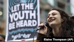 In this Monday, Oct. 29, 2018 file photo, Jamie Margolin, a high school student, speaks during a rally by youth activists and others in Seattle in support of a high-profile climate change lawsuit in federal court in Eugene, Oregon. (AP Photo/Elaine Thompson)