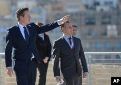 British Prime Minister David Cameron arrives at the St. Angelo Fort in the Three cities, during the CHOGM Commonwealth Heads of Government Meeting in, Malta, Nov. 28, 2015.
