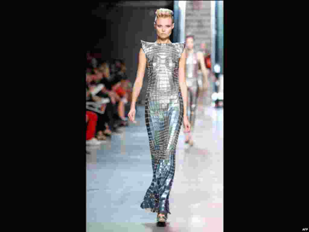 A model wears a creation by Indian fashion designer Manish Arora for Paco Rabanne's spring-summer 2012 ready-to-wear collection, Tuesday, Oct.4, 2011 in Paris.