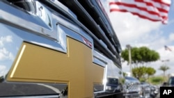 FILE - The Chevrolet logo is displayed at Miami Lakes AutoMall in Miami Lakes, Fla., Oct. 1, 2014.