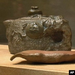 Homei Iseyama, an internee at Topaz, Utah, carved a number of teapots and other objects from slate found at the camp