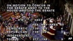In this photo rendered from video via C-SPAN, shows the final vote tally on the bill to avoid income tax increases on Jan. 1