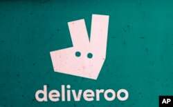 FILE - A Deliveroo logo is seen on a bicycle in London, July 11, 2017.