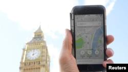 Foto ilustrasi menunjukkan aplikasi Uber di sebuah ponsel di London pusat, Inggris, 22 September 2017.(Foto:Dok)
