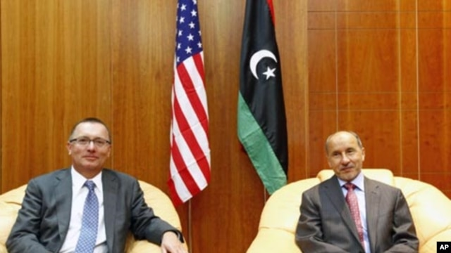Jeffrey Feltman, U.S. Assistant Secretary of State for Near East Affairs, meets with Mostafa Abdel Jalil (R), Chairman of Libya's National Transitional Council interim government in Tripoli, September 14, 2011.