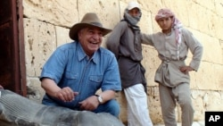 Zahi Hawass displays a Ptolemaic statue discovered at Taposiris Magna, in northern Egypt on 8 May, 2010.