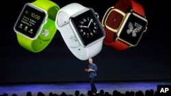 FILE - Apple CEO Tim Cook introduces Apple Watch in Cupertino, California, Sept. 9, 2014.