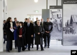 U.S. Vice President Mike Pence, fourth from left, and his wife Karen, third from left, visit the memorial site in the former Nazi concentration camp in Dachau near Munich, southern Germany, Feb. 19, 2017,