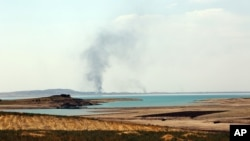 Smoke rises during airstrikes targeting Islamic State militants at the Mosul Dam outside Mosul, Iraq, Aug.18, 2014.