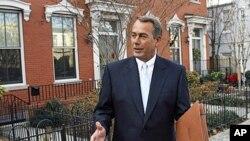 House Speaker-designate John Boehner of Ohio walks out of his home on Capitol Hill in Washington, 05 Jan 2011