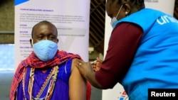 FILE - Kenyan tour guide, Daniel Ole Kissipan, receives a shot of the AstraZeneca/Oxford vaccine in Nairobi, Kenya, April 27, 2021.