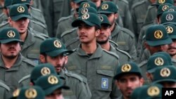 FILE - Iranian Revolutionary Guard members attend a ceremony celebrating the 40th anniversary of the Islamic Revolution, at the Azadi, or Freedom, Square in Tehran, Iran, Feb. 11, 2019.