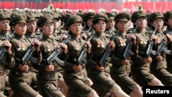 FILE - North Korea's Worker-Peasant Red Guard members attend a parade marking the 1948 establishment of North Korea, in Pyongyang, Sept. 9, 2013.