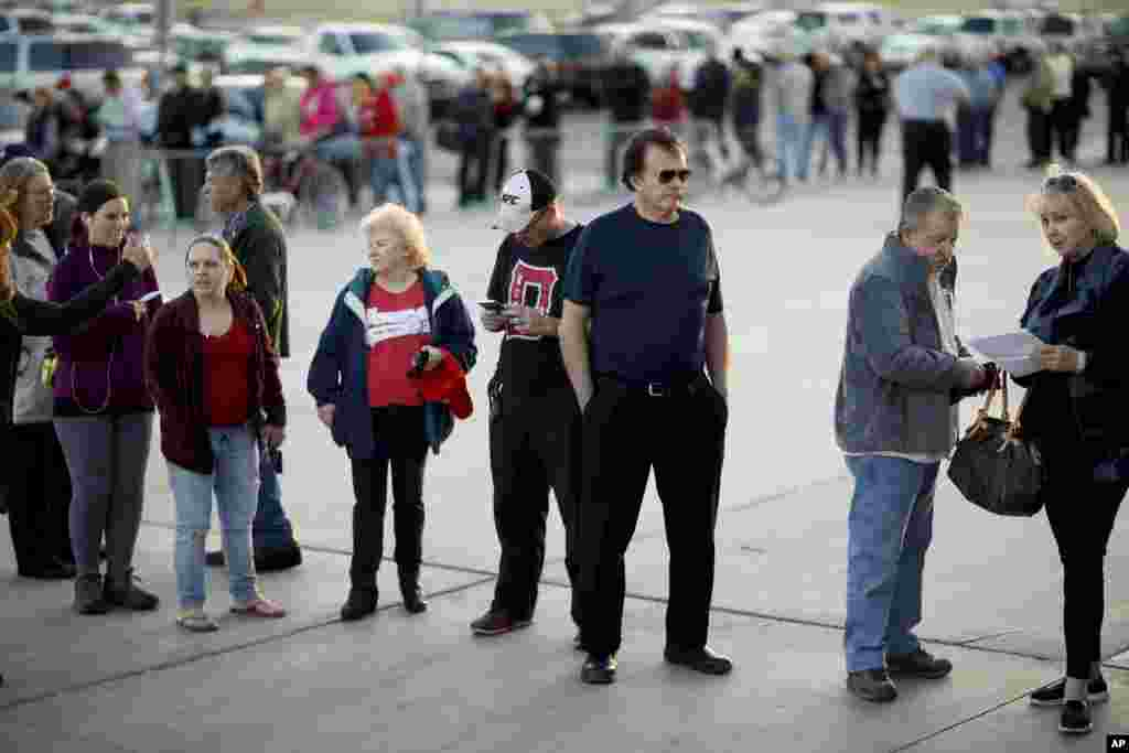 Voters line up outside a Republican caucus site, Feb. 23, 2016, in Las Vegas.