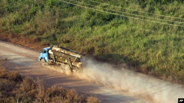 A truck carrying hardwood timber drives along a rural road leading to Paragominas, northern state of Para, Brazil (file photo)