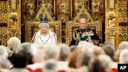 Britain's Queen Elizabeth II and Prince Philip, sit in the House of Lords ahead of the Queen's Speech at the State Opening of Parliament in London, May 18, 2016.