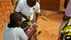 Cameroon launched a polio vaccination campaign for 6.2 million children this year. Volunteers (above) administered the vaccine in Nigeria in 2005.