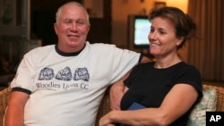 FILE - Roy Bennett, a senior Zimbabwean MDC opposition official, and his wife, Heather, relax at a friends home in Mutare, about 200 kilometers east of Harare, Zimbabwe, following his release from prison. A helicopter crash killed Bennett and his wife whi
