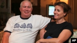 FILE - Roy Bennett, a senior Zimbabwean MDC opposition official, and his wife, Heather, relax at a friends home in Mutare, about 200 kilometers east of Harare, Zimbabwe, following his release from prison. A helicopter crash killed Bennett and his wife.