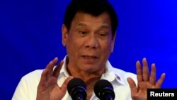 FILE - Philippine President Rodrigo Duterte delivers a speech during the 80th National Bureau of Investigation anniversary, Nov. 14, 2016. On Thursday Duterte said he might withdraw from the International Criminal Court.