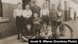 A 1929 photo shows neighborhood boys in Bremen, Germany. It's part of a special exhibit at the U.S. Holocaust Memorial Museum that inspired an art installation by Hungarian students studying anti-discrimination. (US Holocaust Memorial Museum, courtesy of Jacob G. Wiener)