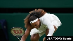 Serena Williams falls to the ground during the first round women's singles on Centre Court at the Wimbledon Tennis Championships in London, June 29, 2021. (Peter Van den Berg-USA Today Sports)