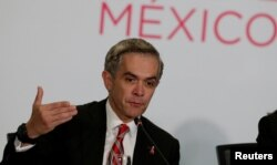 FILE - Mexico City's Mayor Miguel Angel Mancera speaks to the media in Mexico City, Mexico, Dec. 2, 2016.