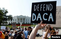 FILE - Demonstrators protest in front of the White House after the Trump administration rescinded the Deferred Action for Childhood Arrivals program, Sept. 5, 2017.