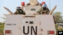 FILE - U.N. peacekeepers in an armored personnel carrier lead a patrol from Bentiu toward the village of Nhialdiu, South Sudan, Dec. 7, 2018.