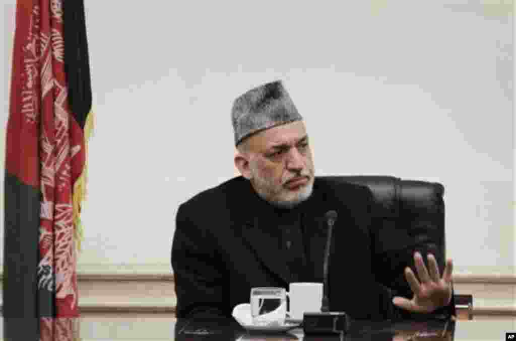 Afghan President Hamid Karzai listens to speeches of a family member,unseen, of Afghan civilians who were killed Sunday by a US soldier in Panjwai in Kandahar province at the presidential palace in Kabul, Afghanistan, Friday, March 16, 2012. Afghan Presid