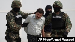 "Joaquin ""El Chapo"" Guzman is escorted to a helicopter in handcuffs by Mexican navy marines at a navy hanger in Mexico City, Mexico, Saturday, Feb. 22, 2014."