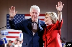 Democratic presidential candidate Hillary Clinton, right, waves on stage with husband and former President Bill Clinton for a Nevada Democratic caucus rally, in Las Vegas, Feb. 20, 2016.
