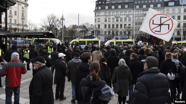 "Counter-demonstrators gather to show their disapproval of a movement calling itself ""The People's Demonstration"", which held a meeting and demonstration at Norrmalmstorg square in Stockholm, Sweden, Jan.30, 2016."