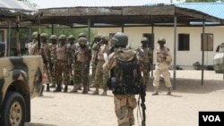 The Nigerian government has deployed thousands of soldiers, such as these in Borno State, to fight Boko Haram in the north, June 6, 2013. (Heather Murdock/VOA)
