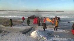 ชาวประมงจีนฉลองเทศกาลตกปลาใต้ทะเลสาบน้ำเเข็ง