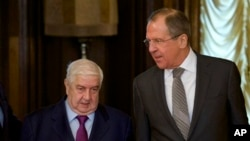 Ngoại trưởng Nga Sergey Lavrov (phải) gặp Ngoại trưởng Syria Walid al-Moallem tại Moscow, ngày 25/2/2013.