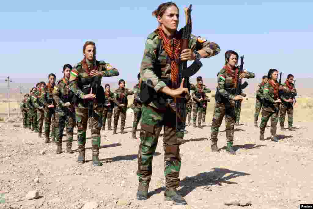 A group of Iranian Kurdish women who have joined Kurdish peshmerga fighters take part in a training session in a military camp in Erbil, Iraq.