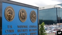 FILE - The sign outside the National Security Agency (NSA) campus in Fort Meade, Md., June 6, 2013. All fingers are pointing to Russia as author of the worst-ever hack of U.S. government agencies.