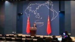 中国促对话解决争端 网民呼吁反美游行
