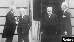 British Prime Minister David Lloyd George, Italian Premier Vittorio Emanuele Orlando, French Premier Georges Clemenceau and President Woodrow Wilson are seen in Versailles.