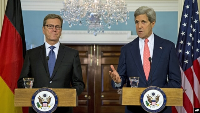 Secretary of State John Kerry (r)  during a news conference with German Foreign Minister Guido Westerwelle at the State Department in Washington, May 31, 2013.