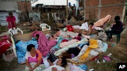 Four families wake up after sleeping outside their homes that collapsed during the earthquake in Manta, Ecuador, Tuesday, April 19, 2016. The strongest earthquake to hit Ecuador in decades flattened buildings and buckled highways along its Pacific coast, sending the Andean nation into a state of emergency.
