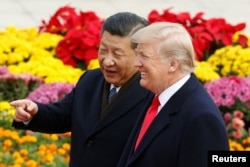 FILE - U.S. President Donald Trump and China's President Xi Jinping attend a welcoming ceremony in Beijing, Nov. 9, 2017.