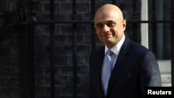 Britain's Home Secretary Sajid Javid arrives in Downing Street in London, May 1, 2018. Javid is to unveil Monday new security measures including the hiring of an extra 1,000 intelligence officers to help keep suspected extremists under better surveillance.