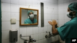 FILE - A Palestinian doctor washes his hands prior to performing a surgery at Shifa hospital in Gaza City, Jan. 27, 2009. Health officials see hand-washing as the single most important measure for preventing surgical site infections.