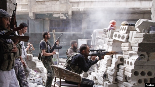 Members of the Free Syrian Army are seen at a front line in al-Mid area in Aleppo city in northern Syria, October 11, 2012.